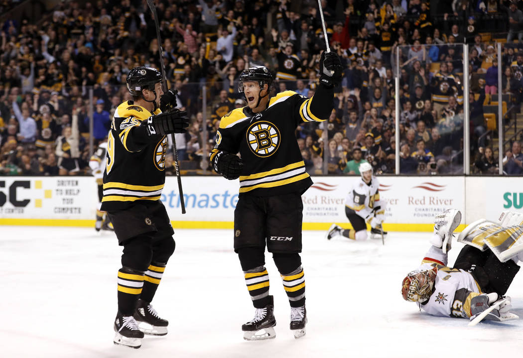 Boston Bruins' Riley Nash, center, celebrates his goal against Vegas Golden Knights goalie Maxime Lagace, right, with teammate Matt Beleskey during the second period of an NHL hockey game in Bosto ...