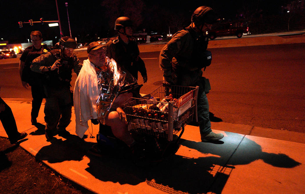 Patrick Carnes is evacuated in a Walmart cart by SWAT medics from the scene of a shooting at a Walmart where Carnes was shopping in Thornton, Colorado, Nov. 1, 2017. (Reuters/Rick Wilking)
