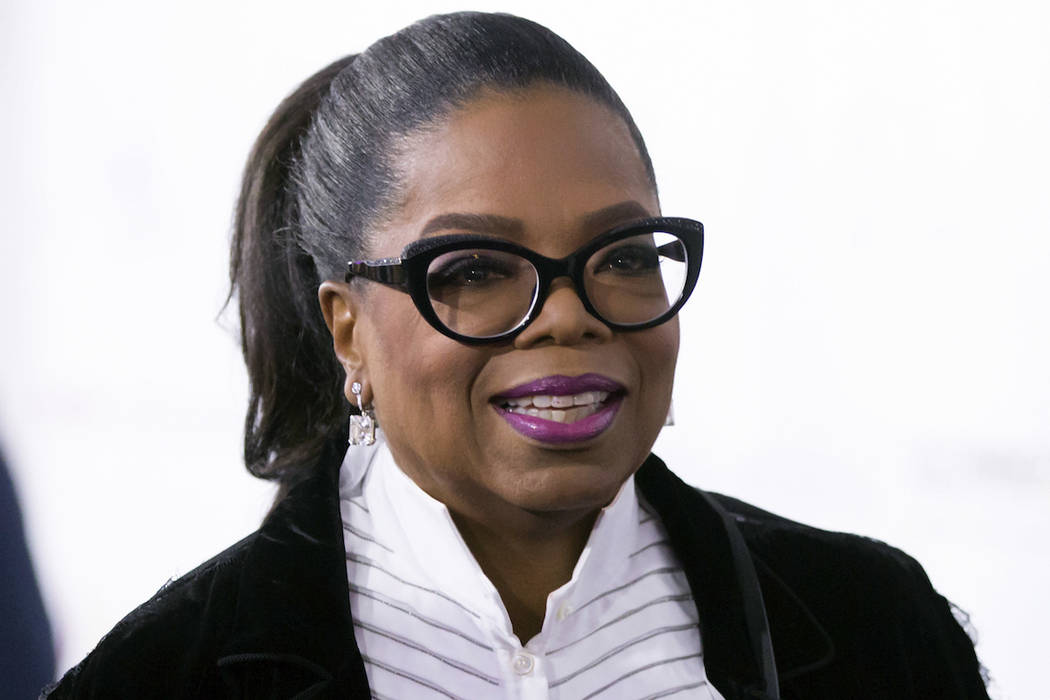 Oprah Winfrey arrives for the David Foster Foundation 30th Anniversary Miracle Gala, in Vancouver, B.C., on Saturday October 21, 2017. (THE CANADIAN PRESS/Darryl Dyck/ via AP)