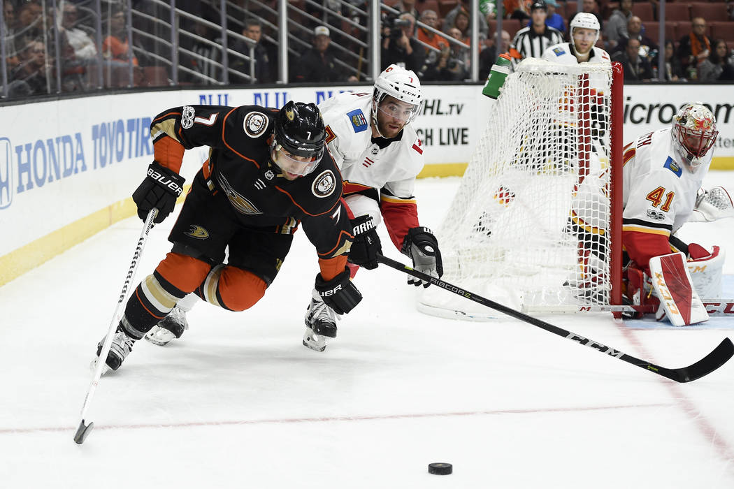 Oct 9, 2017; Anaheim, CA, USA; Anaheim Ducks left wing Andrew Cogliano (7) and Calgary Flames defenseman T.J. Brodie (7) battle for the puck during the first period at Honda Center. Mandatory Cred ...