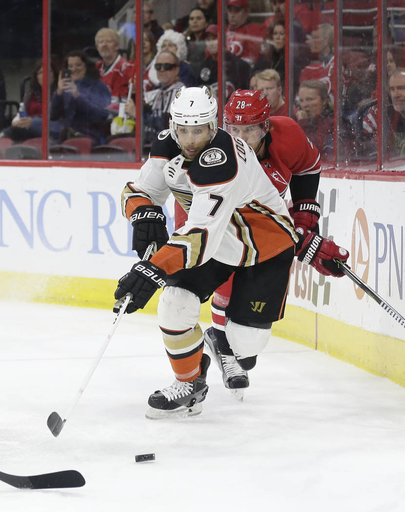Anaheim Ducks' Andrew Cogliano (7) chases the puck during the first period of an NHL hockey game against the Carolina Hurricanes in Raleigh, N.C., Sunday, Oct. 29, 2017. (AP Photo/Gerry Broome)