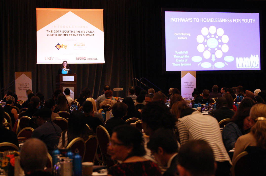 A crowd listens to Darla Bardine, executive director of the National Network for Youth, describe how minors become homeless during during the 2017 Southern Nevada Youth Homeless Summit at The Vene ...
