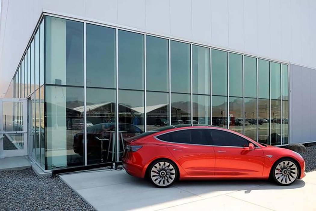 A prototype of the Tesla Model 3 is on display in front of the factory during a media tour of the Tesla Gigafactory, which will produce batteries for the electric carmaker in Sparks, July 26, 2016 ...