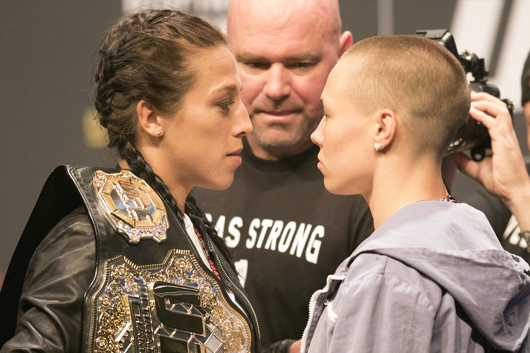UFC strawweight champion Joanna Jedrzejczyk, left, stares down Rose Namajunas at the T-Mobile Arena during the UFC 217 press conference in Las Vegas, Friday, Oct. 6, 2017. Heidi Fang Las Vegas Rev ...