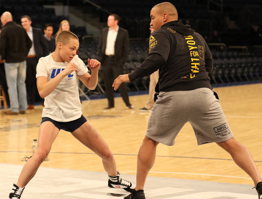 UFC strawweight contender Rose Namajunas, left, spars with her fianc Pat Barry at UFC 217 open workouts at Madison Square Garden in New York, New York, Wednesday, Nov. 1, 2017. Heidi Fang Las Vega ...