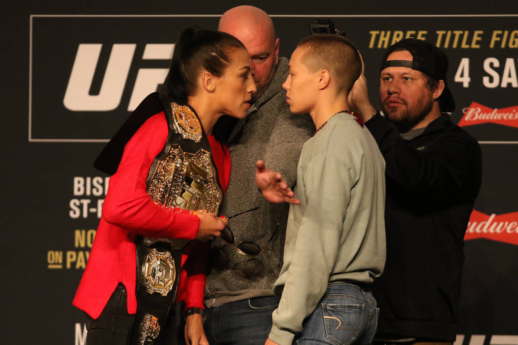 UFC strawweight champion Joanna Jedrzejczyk, left, gets in Rose Namajunas' face during a staredown at the UFC 217 news conference at Madison Square Garden in New York, New York, Thursday, Nov. 2,  ...