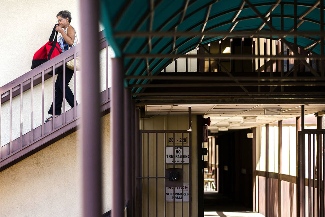 A woman walks down the stairwell at Rose Gardens, a public housing project in North Las Vegas, in 2016. (Las Vegas Review-Journal