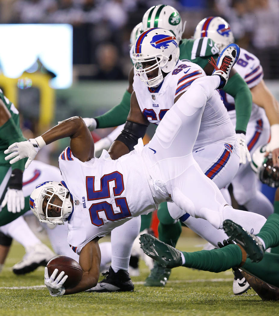 Buffalo Bills running back LeSean McCoy (25) is tripped up near the line of scrimmage during the first half of an NFL football game against the New York Jets, Thursday, Nov. 2, 2017, in East Ruthe ...