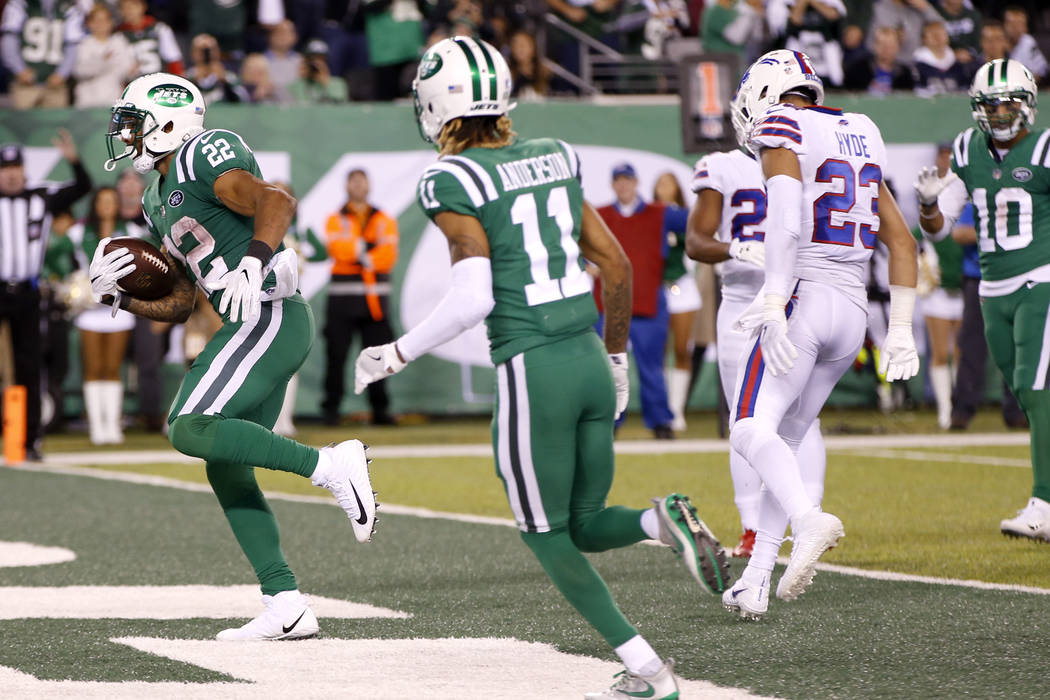 New York Jets running back Matt Forte (22) scores on a touchdown run against the Buffalo Bills during the second half of an NFL football game, Thursday, Nov. 2, 2017, in East Rutherford, N.J. (AP  ...