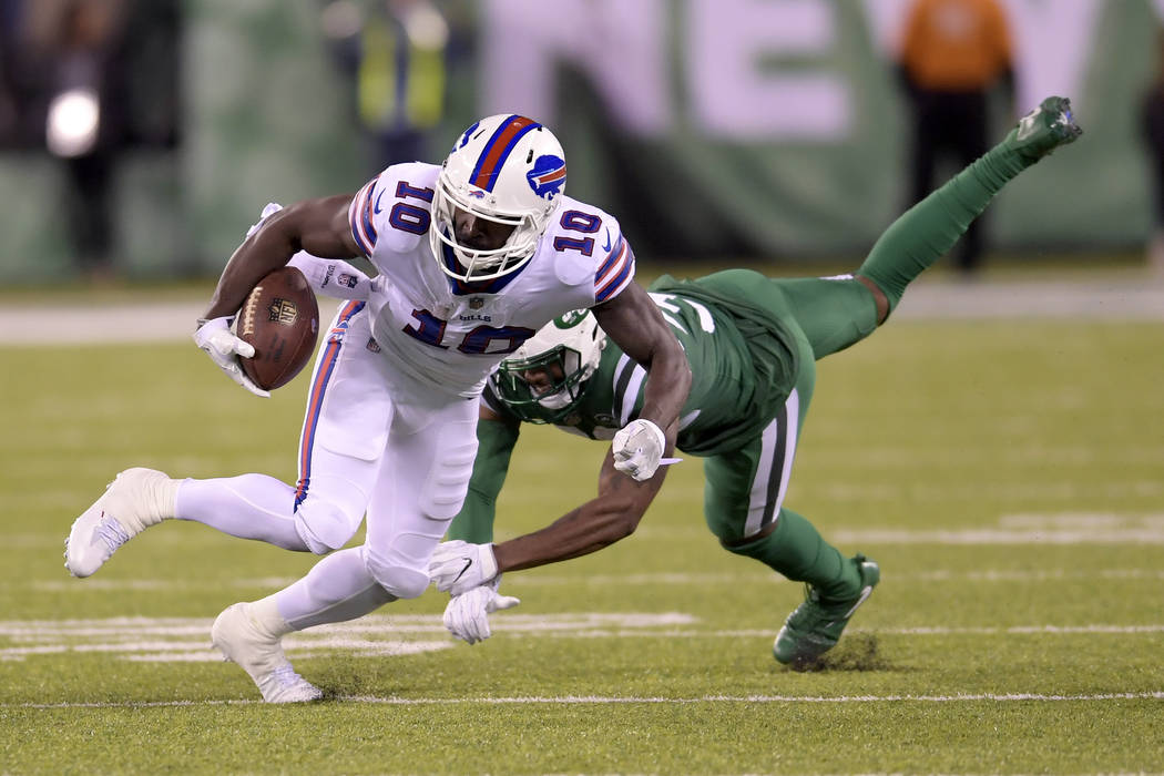 Buffalo Bills wide receiver Deonte Thompson (10) runs with the ball as New York Jets cornerback Juston Burris (32) misses the tackle during the second half of an NFL football game, Thursday, Nov.  ...