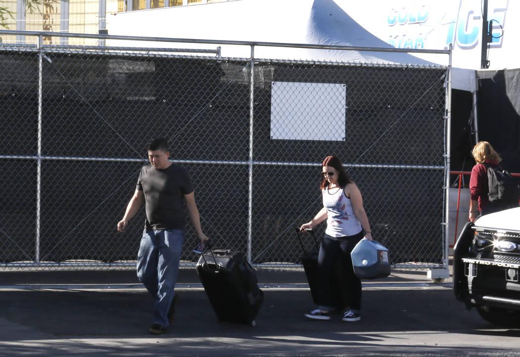 Vendors leave the festival site after reclaiming their property Thursday, Nov. 2, 2017, in Las Vegas. Bizuayehu Tesfaye/Las Vegas Review-Journal @bizutesfaye