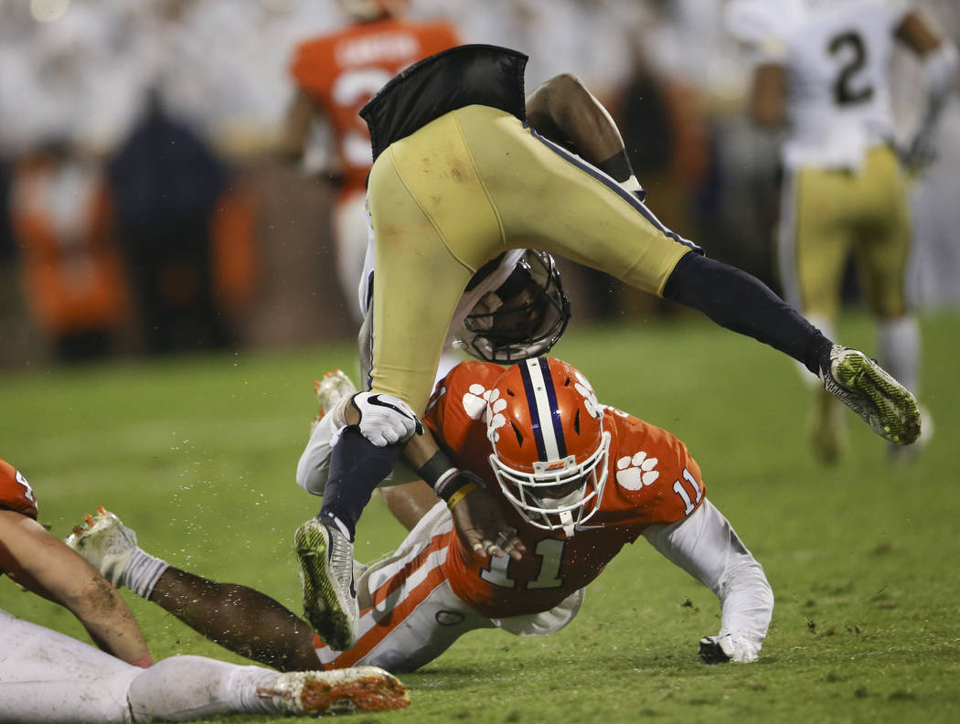 Clemson safety Isaiah Simmons (11) brings down Georgia Tech running back Clinton Lynch (22) in the second half of an NCAA college football game Saturday, Oct. 28, 2017, in Clemson, S.C. (AP Photo/ ...