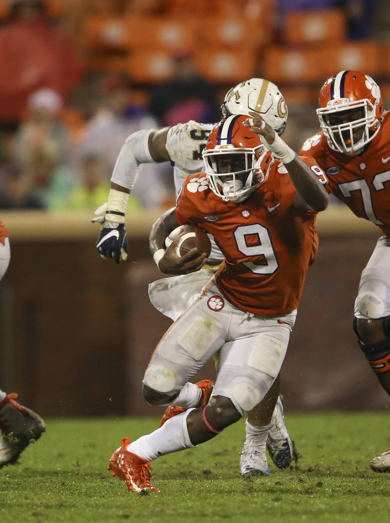 Clemson running back Travis Etienne (9) looks for running room in the second half of an NCAA college football game =against Georgia Tech Saturday, Oct. 28, 2017, in Clemson, S.C. (AP Photo/John Ba ...