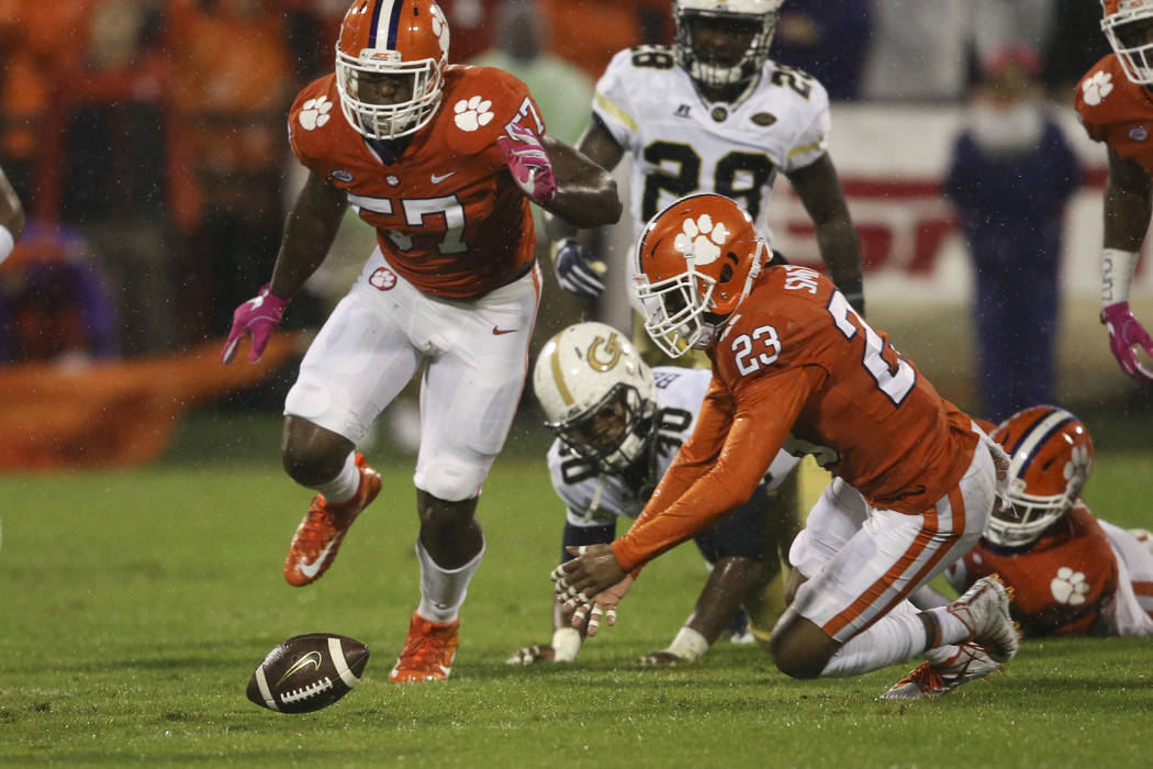 Clemson safety Alex Dalton (27) races to cover a fumble by Georgia Tech running back KirVonte Benson (30) in the first half of an NCAA college football game Saturday, Oct. 28, 2017, in Clemson, S. ...