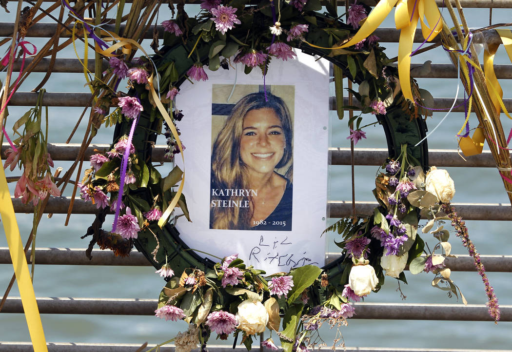 FILE - This July 17, 2015, file photo shows flowers and a portrait of Kate Steinle displayed at a memorial site on Pier 14 in San Francisco, Calif. The bullet that killed Kate Steinle two years ag ...
