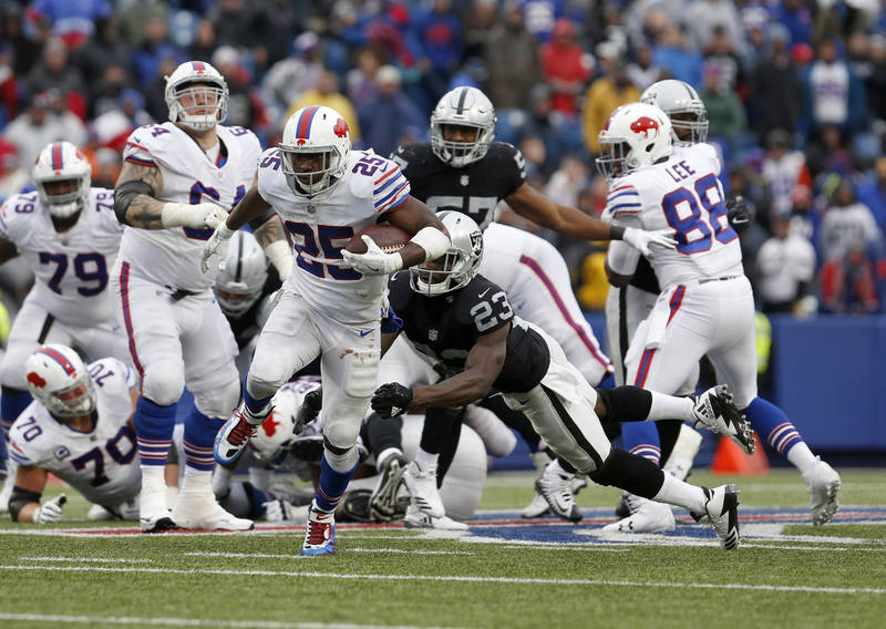 Oct 29, 2017; Orchard Park, NY, USA; Oakland Raiders cornerback Dexter McDonald (23) dives to try and make a tackle on Buffalo Bills running back LeSean McCoy (25) as he runs the ball during the s ...