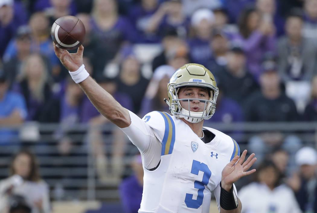 UCLA quarterback Josh Rosen throws against Washington in the first half of an NCAA college football game Saturday, Oct. 28, 2017, in Seattle. (AP Photo/Elaine Thompson)