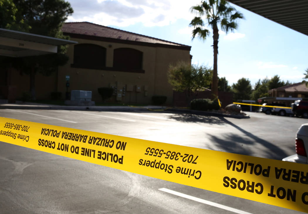 Henderson police use yellow tape to close off the crime scene inside an apartment complex in the 900 block of Seven Hills Drive where a juvenile was shot and hospitalized on Thursday, Nov. 2, 2017 ...