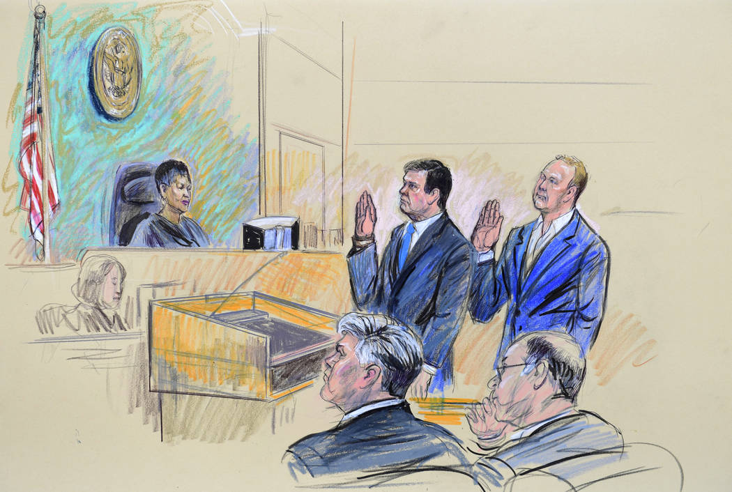 A court artist drawing shows President Donald Trump's former campaign chairman, Paul Manafort, center standing and Manafort's business associate, Rick Gates, in federal court in Washington, Monday ...