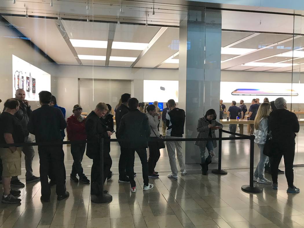 People line up to get the new Apple iPhone X at Fashion Show Mall, Friday, Nov. 3, 2017. Harrison Keely/Las Vegas Review-Journal