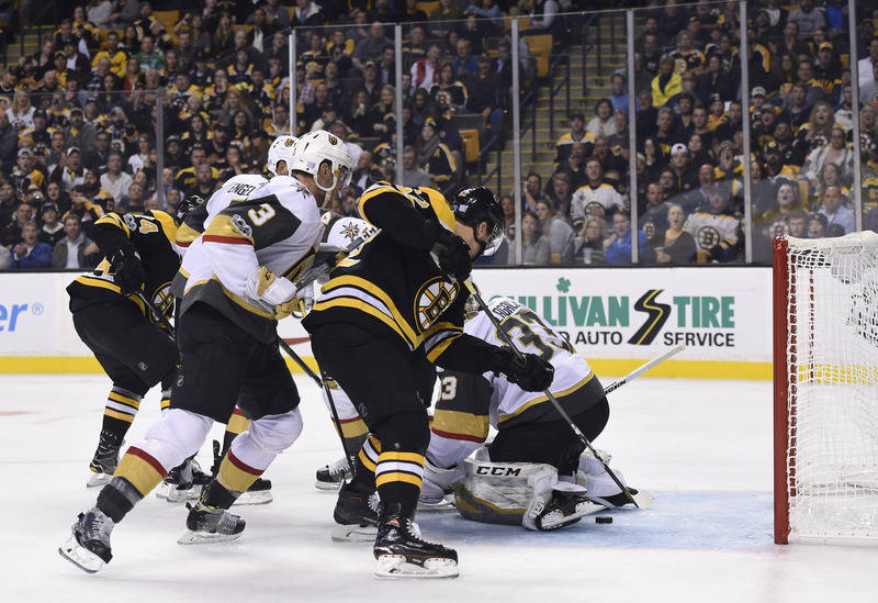 Nov 2, 2017; Boston, MA, USA; Boston Bruins center Sean Kuraly (52) scores a goal past Vegas Golden Knights goalie Maxime Lagace (33) during the third period at TD Garden. Mandatory Credit: Bob De ...