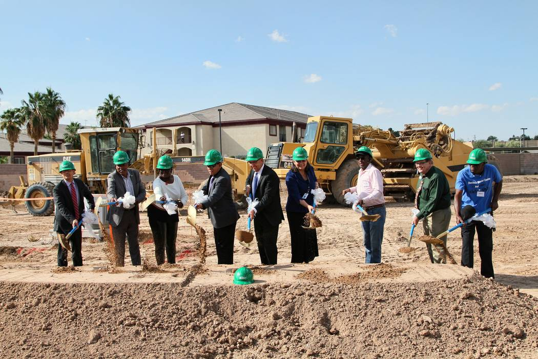 City officials and residents take first dig at the site on Nov. 2, 2017 where the new Rose Gardens Senior Apartments will be built. (Courtesy of Nancy Katz)