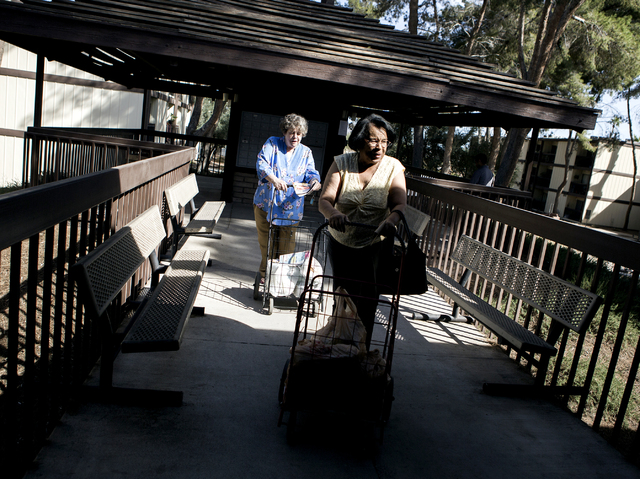 Tenants Leslie Howell, left, and Barbara Patton push carts at Rose Gardens, 1632 Yale Street, on Wednesday, March 3, 2016. North Las Vegas city council will vote on whether to allocate $500,000 in ...