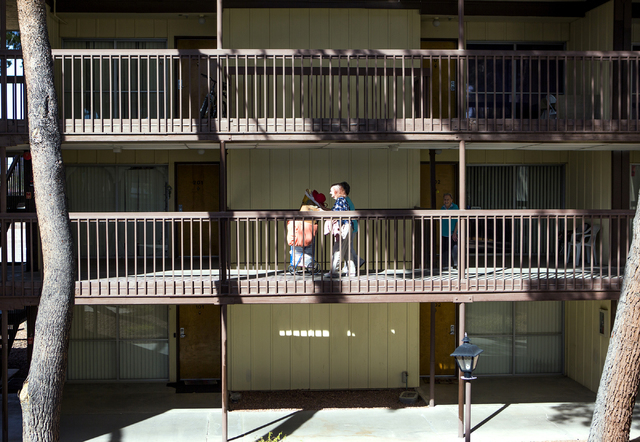 Women walk on the second floor at Rose Gardens, 1632 Yale Street, on Wednesday, March 3, 2016. North Las Vegas city council will vote on whether to allocate $500,000 in grant money toward rebuildi ...
