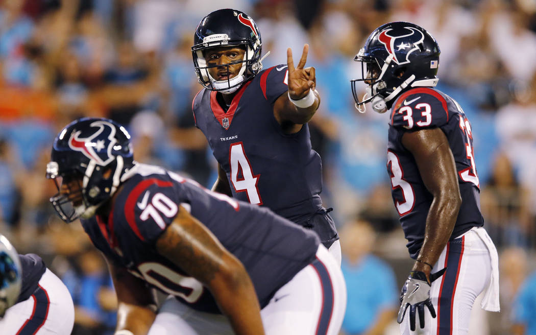 In this Aug. 9, 2017, file photo, Houston Texans quarterback Deshaun Watson (4) gestures at the line of scrimmage  during the first half of an NFL preseason football game against the Carolina Pant ...