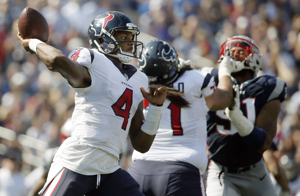 In this Sept. 24, 2017, file photo, Houston Texans quarterback Deshaun Watson (4) throws a pass against the New England Patriots during the first half of an NFL football game in Foxborough, Mass.  ...