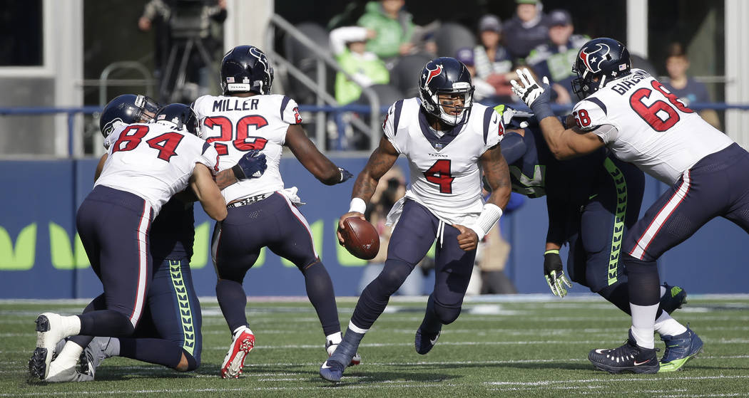 Houston Texans quarterback Deshaun Watson (4) scrambles against the Seattle Seahawks in the first half of an NFL football game, Sunday, Oct. 29, 2017, in Seattle. (AP Photo/Elaine Thompson)