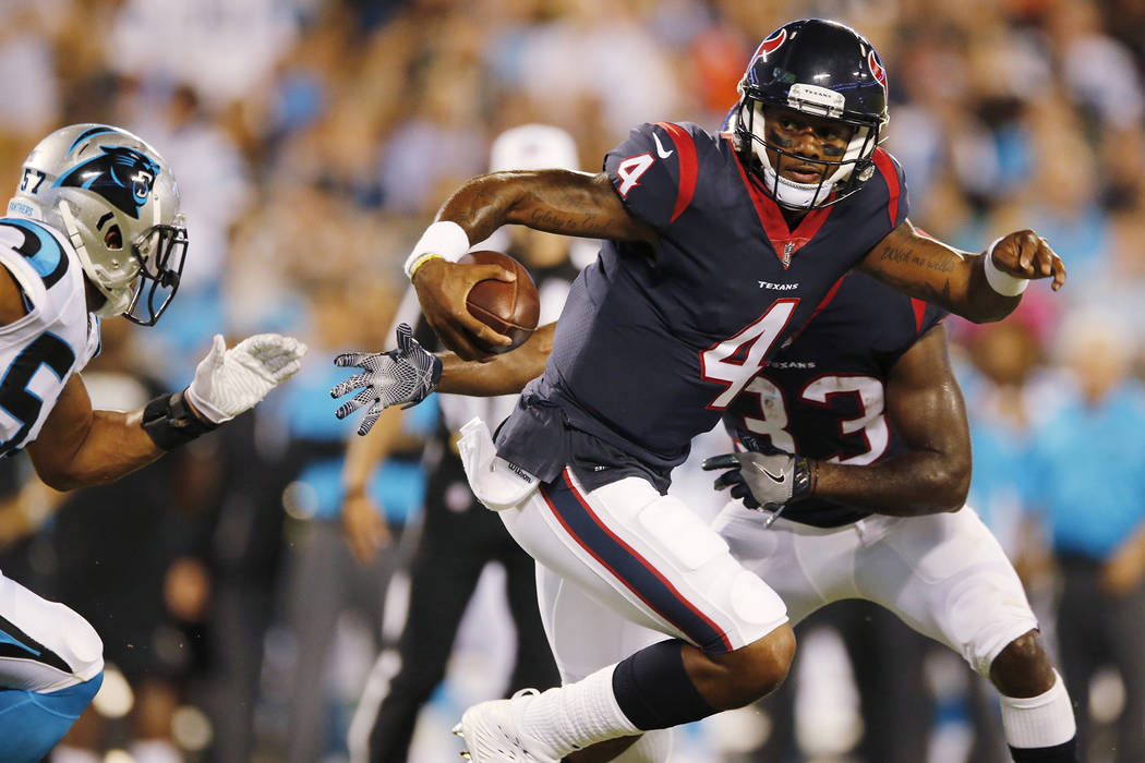 In this Aug. 9, 2017, file photo, Houston Texans quarterback Deshaun Watson (4) runs against the Carolina Panthers during the first half of an NFL preseason football game in Charlotte, N.C. Two pe ...