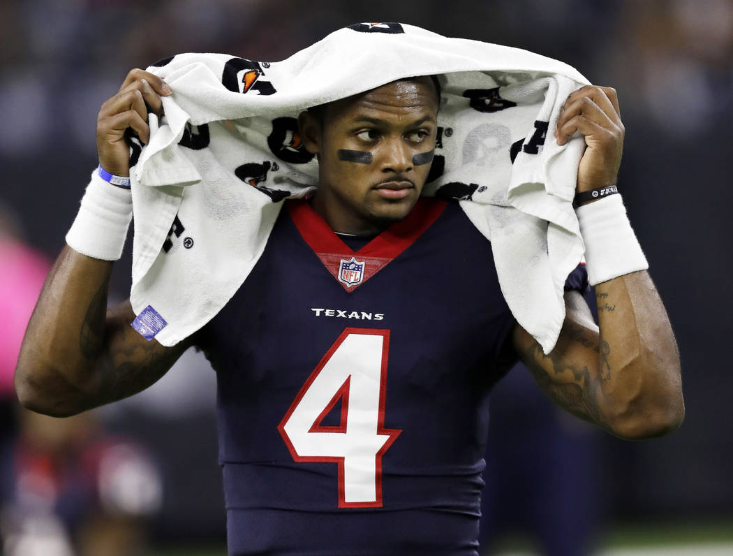In this Oct. 8, 2017, file photo, Houston Texans quarterback Deshaun Watson (4) before an NFL football game Kansas City Chiefs in Houston. Two people familiar with the situation tell The Associate ...