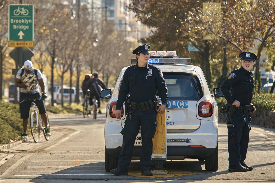 Police stand guard at the intersection of Houston and West streets on  Thursday, Nov. 2, 2017, in New York.  A man in a rented pickup truck mowed down pedestrians and cyclists along the busy bike  ...