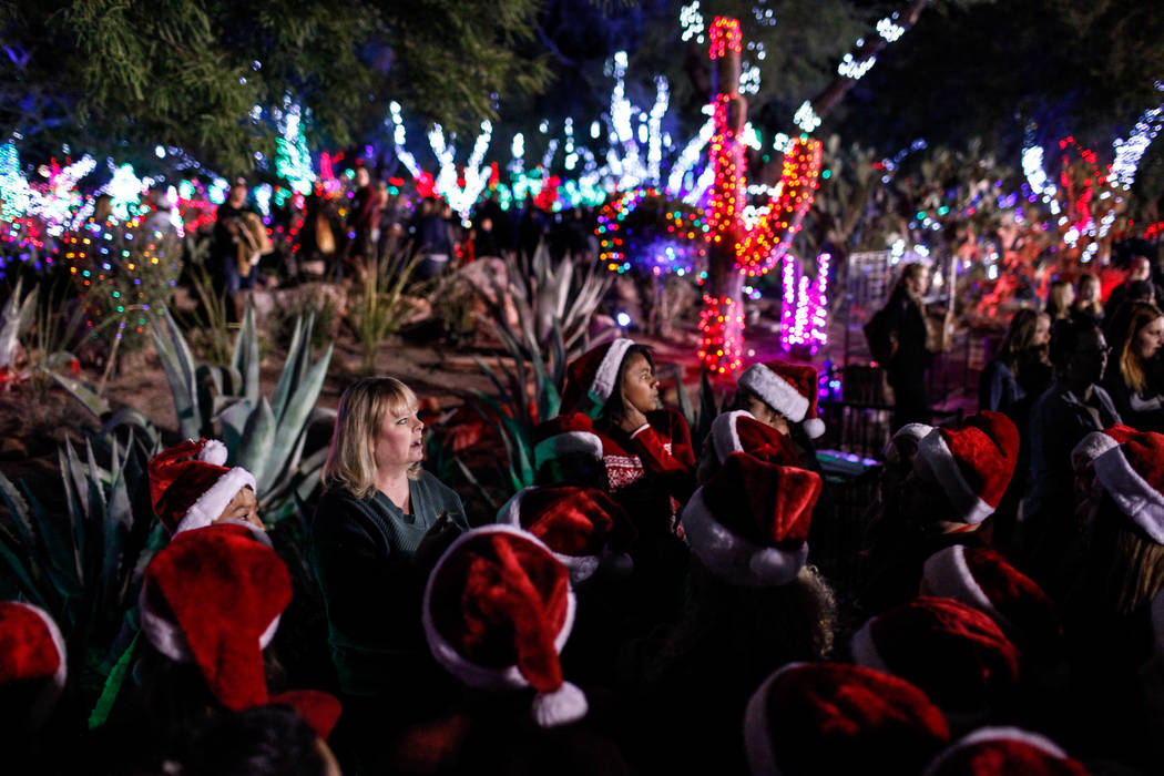 Schofield Middle School Choir Teacher Deborah Fletcher, left, leads her students in a song during the 24th Annual Holiday Cactus Garden in Henderson, Tuesday, Nov. 7, 2017. Joel Angel Juarez Las V ...
