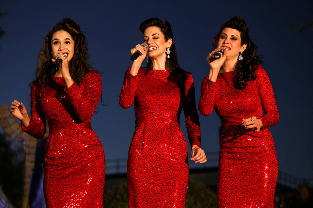 Jaclyn McSpadden, left, Elly Brown, center, and Shannon Huslig, right, of The Sound Collage, perform during the 24th Annual Holiday Cactus Garden in Henderson, Tuesday, Nov. 7, 2017. Joel Angel Ju ...