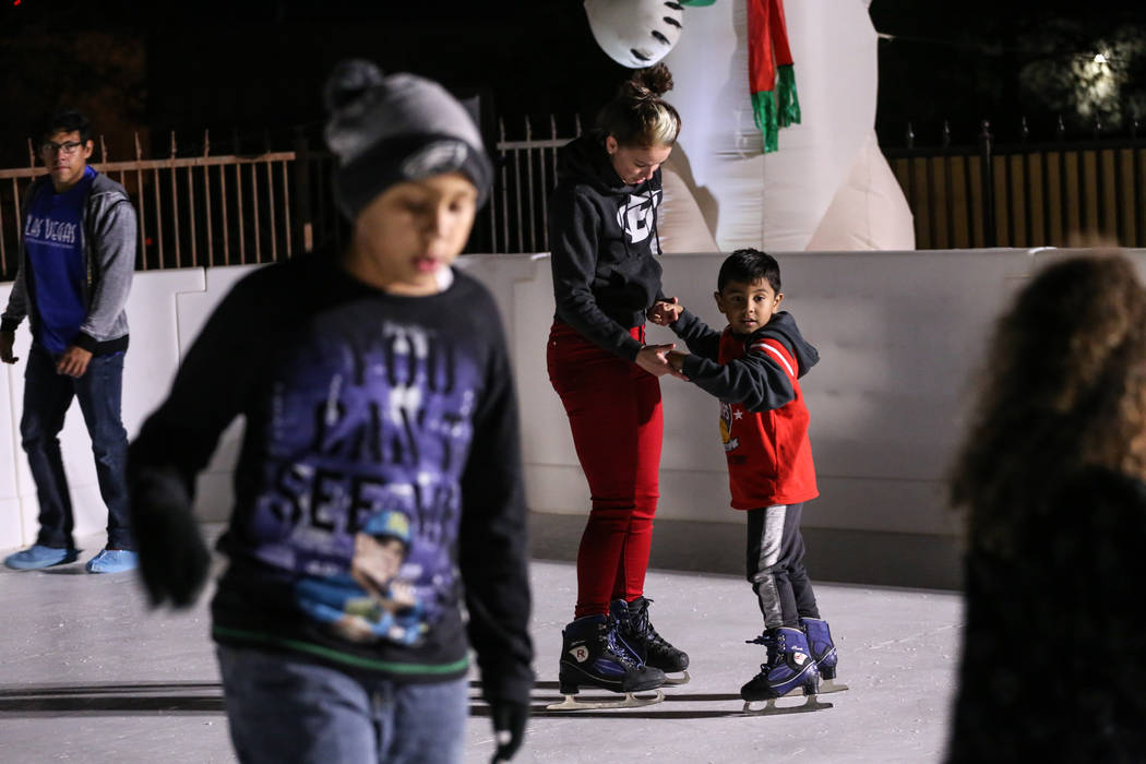 Heather Hernandez, 26, left, helps Nacho Gomez, 4, right, to ice skate during the 24th Annual Holiday Cactus Garden in Henderson, Tuesday, Nov. 7, 2017. Joel Angel Juarez Las Vegas Review-Journal  ...