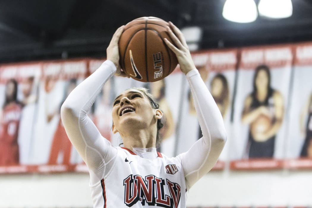 UNLV's Katie Powell (21) drives to the basket during the Rebels home matchup with Air Force on Wednesday, Feb. 22, 2017, at Cox Pavilion, in Las Vegas.  (Benjamin Hager/Las Vegas Review-Journal) @ ...
