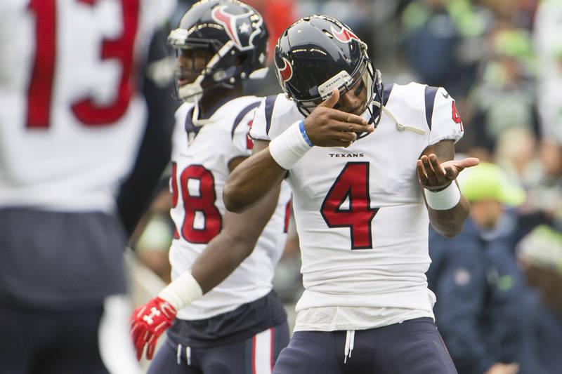 Oct 29, 2017; Seattle, WA, USA; Houston Texans quarterback Deshaun Watson (4) dances to music during pregame warm up before a game again the Seattle Seahawks at CenturyLink Field. Mandatory Credit ...
