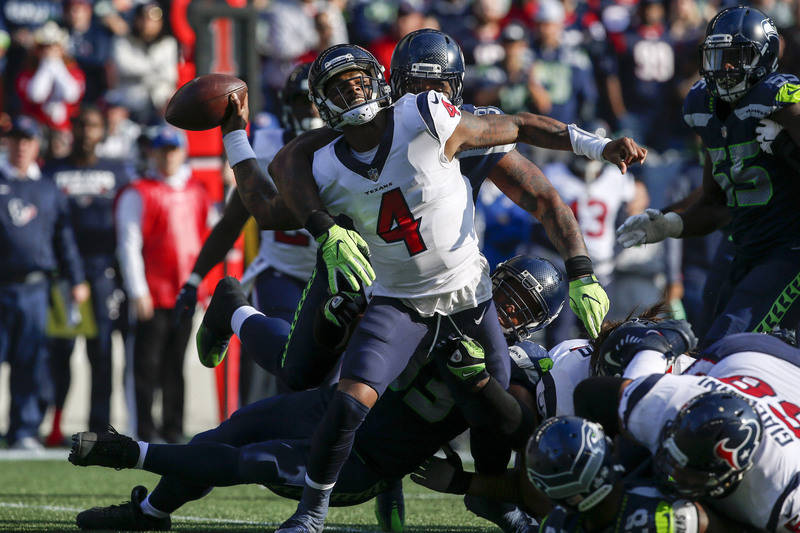 Oct 29, 2017; Seattle, WA, USA; Houston Texans quarterback Deshaun Watson (4) is sacked by Seattle Seahawks defensive end Dwight Freeney (93) during the second quarter at CenturyLink Field. Mandat ...
