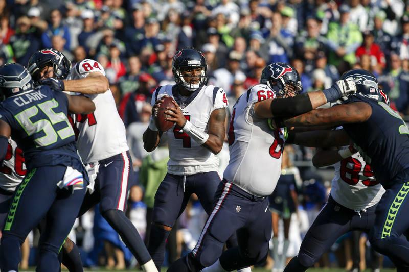 Oct 29, 2017; Seattle, WA, USA; Houston Texans quarterback Deshaun Watson (4) looks to pass against the Seattle Seahawks during the second quarter at CenturyLink Field. Mandatory Credit: Joe Nicho ...