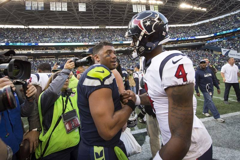 Oct 29, 2017; Seattle, WA, USA; Seattle Seahawks quarterback Russell Wilson (3) embraces Houston Texans quarterback Deshaun Watson (4) after a game at CenturyLink Field. The Seahawks won 41-38. Ma ...