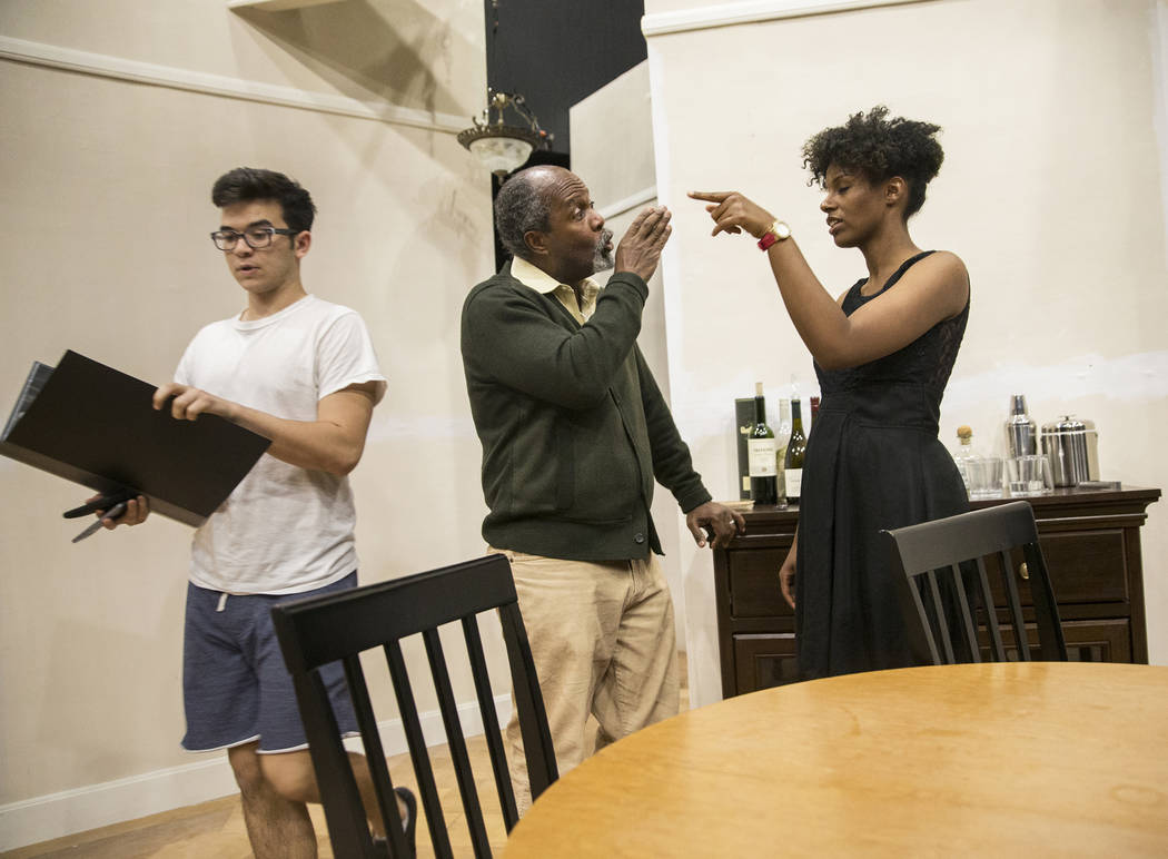 """Director Clarence Gilyard, middle, gives feedback to actress Alexis Hudson during rehearsal for the Pulitzer Prize-winning play """"Disgraced"""" at the Black Box Theatre on Wednesday, ..."""