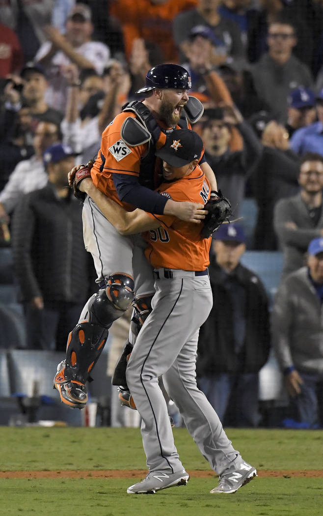 Houston Astros catcher Brian McCann and starting pitcher Charlie Morton celebrate after win against the Los Angeles Dodgers in Game 7 of baseball's World Series Wednesday, Nov. 1, 2017, in Los Ang ...