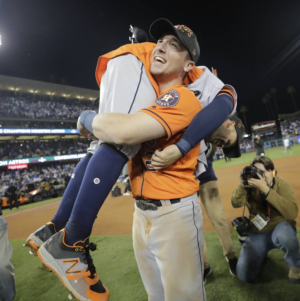Houston Astros' Jose Altuve and Alex Bregman celebrate after Game 7 of baseball's World Series against the Los Angeles Dodgers Wednesday, Nov. 1, 2017, in Los Angeles. The Astros won 5-1 to win th ...