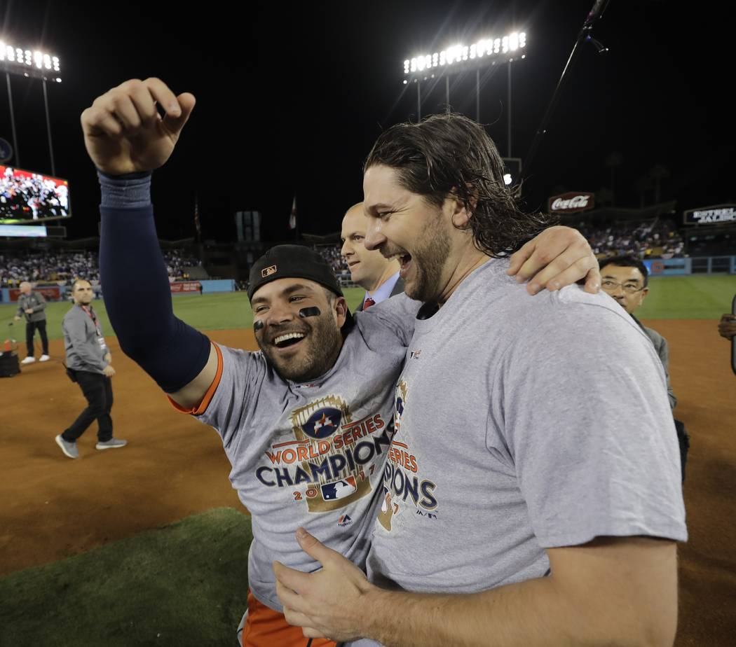 Houston Astros' Jose Altuve and Jake Marisnick celebrate after Game 7 of baseball's World Series against the Los Angeles Dodgers Wednesday, Nov. 1, 2017, in Los Angeles. The Astros won 5-1 to win  ...