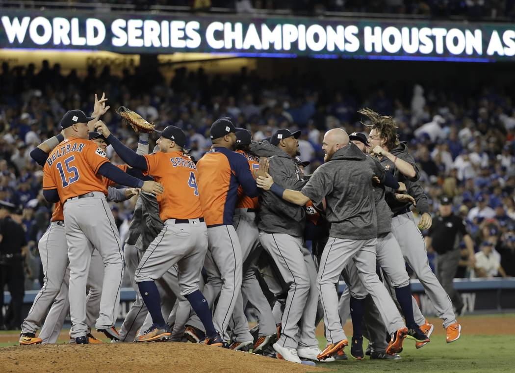 The Houston Astros celebrate after Game 7 of baseball's World Series against the Los Angeles Dodgers Wednesday, Nov. 1, 2017, in Los Angeles. The Astros won 5-1 to win the series 4-3. (AP Photo/Da ...