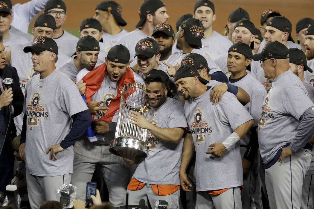 The Houston Astros celebrate with the trophy after their win against the Los Angeles Dodgers in Game 7 of baseball's World Series Wednesday, Nov. 1, 2017, in Los Angeles. The Astros won 5-1 to win ...