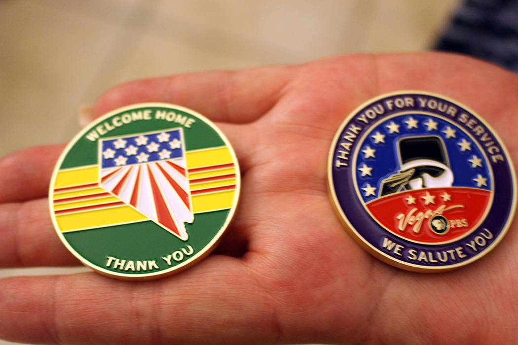 Debra Solt, director of workforce at Vegas PBS, holds the coins designed for Vietnam veterans at Nevada State Veterans Home in Boulder City on Nov. 3, 2017. The coins were sponsored by the Vietnam ...