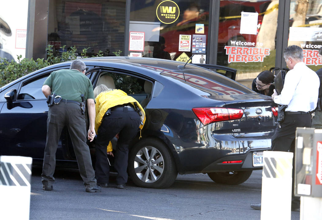 Las Vegas police are investigating after a man was found shot to death in a car at a Terrible's gas station at Durango Drive and Flamingo Road, Thursday, Oct. 26, 2017, in Las Vegas. (Bizuayehu Te ...